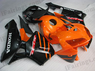 Honda CBR600RR 2005 2006 orange and blackfairing kits, this Honda CBR600RR 2005 2006 plastics was applied in orange and blackgraphics, this 2005 2006 CBR600RR fairing set comes with the both color and decals shown as the photo.If you want to do custom fairings for CBR600RR 2005 2006,our talented airbrusher will custom it for you