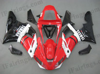 Yamaha YZF-R1 2000 2001 red and glossy black fairing kits, this Yamaha YZF-R1 2000 2001 plastics was applied in red and glossy blackgraphics, this 2000 2001 YZF-R1 fairing set comes with the both color and decals shown as the photo.If you want to do custom fairings for YZF-R1 2000 2001,our talented airbrusher will custom it for you.