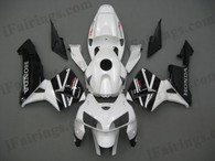 Honda CBR600RR 2005 2006 white/black fairing kits, this Honda CBR600RR 2005 2006 plastics was applied in white/blackgraphics, this 2005 2006 CBR600RR fairing set comes with the both color and decals shown as the photo.If you want to do custom fairings for CBR600RR 2005 2006,our talented airbrusher will custom it for you.