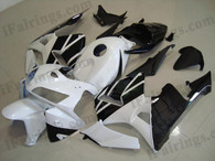 Honda CBR600RR 2005 2006 white and black fairing kits, this Honda CBR600RR 2005 2006 plastics was applied in white and black graphics, this 2005 2006 CBR600RR fairing set comes with the both color and decals shown as the photo.If you want to do custom fairings for CBR600RR 2005 2006,our talented airbrusher will custom it for you.