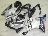 Honda CBR600 F4i 2001 2002 2003 silver/black repsol fairing kits, this Honda CBR600 F4i 2001 2002 2003 plastics was applied in silver/black repsol graphics, this 2001 2002 2003 CBR600 fairing set comes with the both color and decals shown as the photo.If you want to do custom fairings for CBR600 F4i 2001 2002 2003,our talented airbrusher will custom it for you