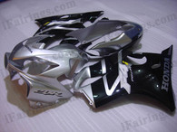 Honda CBR600 F4i 2004 2005 2006 2007 silver and black fairing kits, this Honda CBR600 F4i 2004 2005 2006 2007 plastics was applied in silver and black graphics, this 2004 2005 2006 2007 CBR600 fairing set comes with the both color and decals shown as the photo.If you want to do custom fairings for CBR600 F4i 2004 2005 2006 2007,our talented airbrusher will custom it for you
