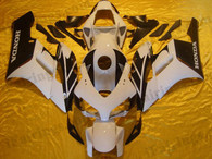Honda CBR1000RR 2004 2005 white and black fairing kits, this Honda CBR1000RR 2004 2005 plastics was applied in white and blackgraphics, this 2004 2005 CBR1000RR fairing set comes with the both color and decals shown as the photo.If you want to do custom fairings for CBR1000RR 2004 2005,our talented airbrusher will custom it for you