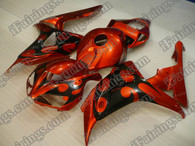 Honda CBR1000RR 2006 2007 orange and black flame fairing kits, this Honda CBR1000RR 2006 2007 plastics was applied in orange and black flamegraphics, this 2006 2007 CBR1000RR fairing set comes with the both color and decals shown as the photo.If you want to do custom fairings for CBR1000RR 2006 2007,our talented airbrusher will custom it for you.