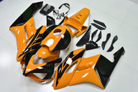 2004 2005 Honda CBR1000RR yellow/black aftermarket fairings.