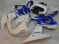 Yamaha YZF-R6 2003 2004 2005 white and blue fairing kits, this Yamaha YZF-R6 2003 2004 2005 plastics was applied in white and bluegraphics, this 2003 2004 2005 YZF-R6 fairing set comes with the both color and decals shown as the photo.If you want to do custom fairings for YZF-R6 2003 2004 2005,our talented airbrusher will custom it for you.
