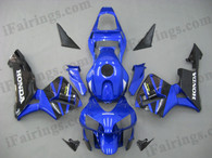 Honda CBR600RR 2003 2004 candy blue and black fairing kits, this Honda CBR600RR 2003 2004 plastics was applied in candy blue and black graphics, this 2003 2004 CBR600RR fairing set comes with the both color and decals shown as the photo.If you want to do custom fairings for CBR600RR 2003 2004,our talented airbrusher will custom it for you