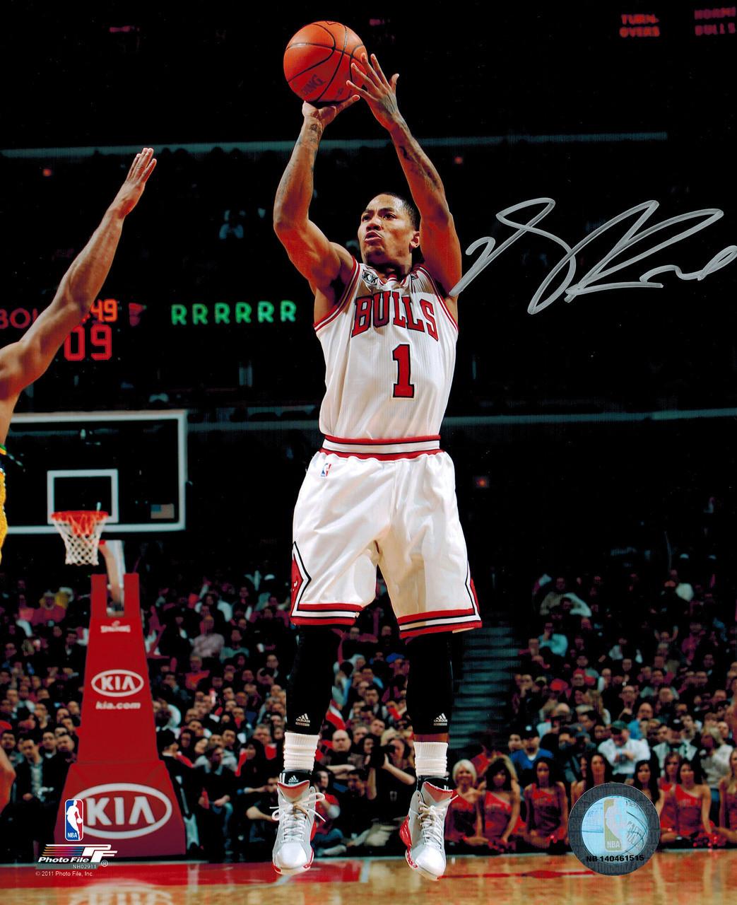 best service a4a73 513f4 Derrick Rose Autographed Chicago Bulls White Jersey Action 8x10 Photo