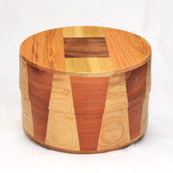Round Wood Cremation Urn in Oak & Goncalo Alves