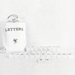 11x19.75x.25 bag 70 pcs 1.5x1.75x.25 (NEWSPAPER - LETTERS) wh/bk