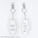 1.7x3.5x.5 rvs wd keychain (SMLE LVE) wh/bk