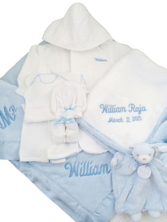 Going clockwise from top,  White Velour Terrycloth Bathrobe, Little Giraffe Blue Luxe Hooded Towel, Blue Kaloo Dou Dou, Little Giraffe Blue Luxe Crib Blanket, Little Giraffe Blue Luxe Blanky, Lap Tee and Boxer Short Outfit,  Matching Hat & Booties