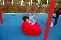 Kid falling into bean bag