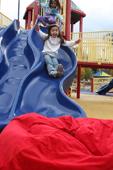 Kid sliding into bean bag chair