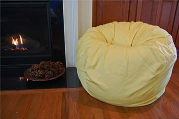 Yellow bean bag brings pastel touch to room