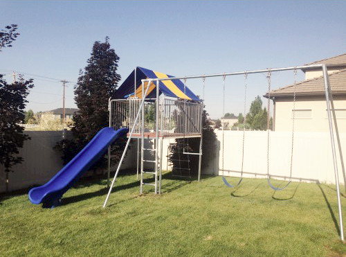 Metal Clubhouse Swing Set with 2 Swings lifestyle