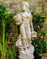 Stone Cast Garden Statue of a Large Basket Lady with www.discountgardenstatues.co.uk
