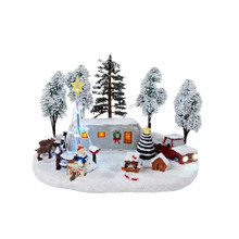This 12-in B/O Christmas LED Scene from Kurt Adler is a fun and festive addition to any holiday decoration! Its design features a bright white winter scene. A trailer is decorated for the holidays, and is surrounded by trees, a snowman, animals, a picnic table, a doghouse, and a pickup truck. When switched on, this piece is illuminated by LED lights for an extra festive touch! B/O, this piece 3 AA batteries (not included).