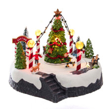 """Add a fun and festive touch to your holiday decoration with this 7-in B/O Musical LED Ice Rink with Tree Table Piece from Kurt Adler! This table piece features children ice skating around a decorated Christmas tree. When turned on, the lights go on and the tune """"Jingle Bells"""" plays."""