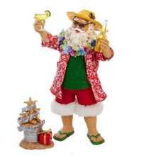 Part of Kurt Adler's Fabriche' collection, this 10-in Fabriche' Beach Santa Set of 2 Pieces is a fun and festive addition to any holiday decoration! Santa Claus is featured here ready for a day at the beach. He is wearing a sun hat, sunglasses, and a tropical shirt (with white-trimmed red shorts, of course). He has a margarita in one hand, a beer in his other hand, and a sand Christmas tree at his feet!