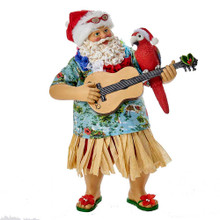 """Part of Kurt Adler's Fabriche' collection, this 11"""" Fabriche' Beach Santa is a fun and festive addition to any holiday decoration. Santa Claus is featured here ready for a day at the beach, with a Hawaiian shirt, grass skirt, guitar, and parrot buddy. Of course, he is also wearing his signature red and white hat."""
