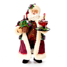 Part of Kurt Adler's Fabriche collection, this 11.5-in Fabriche Santa with Wine Basket from Kurt Adler is a fun and festive addition to any holiday decoration. Perfect for wine lovers, Santa Claus is featured here dressed in a burgundy coat and hat while holding a basket of wine in one hand, and a serving tray of wine in his other hand.