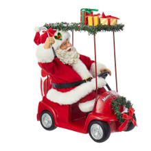 """Part of Kurt Adler's Fabriche collection, this 11.25-in Fabriche Santa Driving Golf Cart from Kurt Adler is a fun and festive addition to any holiday decoration. Perfect for golf fans, Santa Claus is featured here wearing his traditional red and white hat and suit. He is sitting in a red golf cart that reads """"Merry Christmas"""" and is decorated with presents, garland, and a wreath for an extra festive touch."""
