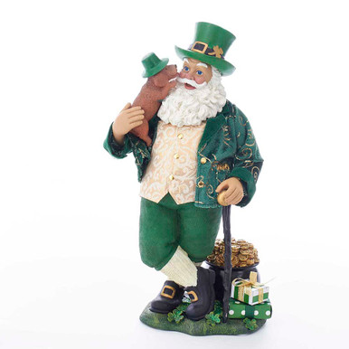 """Part of Kurt Adler's Fabriche collection, this 11-in Musical Irish Santa is a fun and festive way to being the luck of the Irish to any holiday decoration. Santa Claus is featured in a traditional green Irish outfit. He's holding his Irish Setter and has a black thorn walking cane. Surrounded by gifts and a pot o' gold at his feet, this piece, when activated sings the classic Irish tune """"Danny Boy."""""""