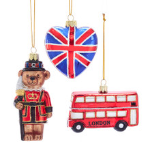 """Decorate your home with this set of 4.5-in Britain Inspired Glass Ornaments from Kurt Adler. This set features a bear in the royal guard attire, a heart with the Union Jack design, and a double decker bus with the word """"LONDON"""" across the side. Show your pride with these country inspired ornaments!"""