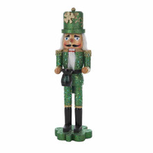 """This Kurt Adler 15"""" Wooden Irish Nutcracker on Shamrock Base is a fun, festive way to add to your holiday decoration or nutcracker collection. This glittering nutcracker shines in green, wears a tall gold shamrock hat, and holds a pot of gold - perfect for celebrating your Irish heritage or for St. Patrick's day!"""