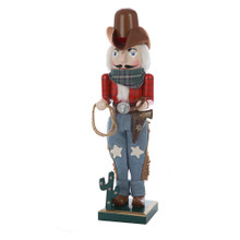 """The Kurt Adler 15"""" Wooden Cowboy Nutcracker is a fun, festive way to add to your holiday decoration or nutcracker collection. This fun Western nutcracker wears a cowboy hat, a plaid shirt tucked into suede fringed jeans, and a big silver rodeo belt buckle. Accents like a lasso, a gun tucked into his belted holster, a horse shoe, and miniature cactus complete his wrangler look."""