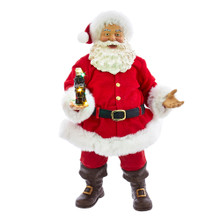 The 10.5-in Coca-Cola Santa with LED Bottle Table Piece from Kurt Adler is a great addition to your Christmas decoration. The table piece features Santa standing wearing his traditional red and white suit, complete with matching hat. In his hand is a glass bottle of Coke adorned with LED lights.