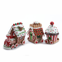 """Add some color and light to your holiday decoration with this 4.3"""" Claydough 3D LED Train Set of 3 Pieces by Kurt Adler. Each piece in this set features a fun gingerbread house-inspired design in the style of different parts of a train. When switched on, these sweet-looking train cars are illuminated from within by LED lighting for a festive touch!"""
