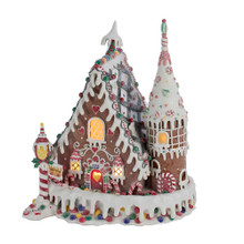 Add a sweet touch to your holiday decoration with this 13-in Claydough Gingerbread Inn with C7 Bulb from Kurt Adler! Its delicious-looking design has everything you would want in a classic gingerbread house, from the icing snow to the candy embellishments. When plugged in, the house lights up from within with Its C7 bulb.