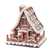 """Add a fun, classic touch to your holiday decoration with this 10"""" B/O Claydough LED Gingerbread House Tabletop from Kurt Adler. This house is festively decorated with gingerbread and candy-inspired detailing. When switched on, this piece lights up. The included timer function features 6 hours on and 18 hours off. B/O; uses 3 AA batteries (not included)."""