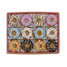 Add a sweet touch to any holiday decoration with this assortment of 6 donut ornaments from Kurt Adler! Each foam donut is realistically designed and detailed. This assortment includes a pink frosted donut with green icing, a chocolate frosted donut, a white frosted donut with rainbow sprinkles, a pink frosted donut with rainbow sprinkles, a blue frosted donut with rainbow sprinkles and a chocolate frosted donut with rainbow sprinkles.
