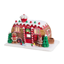 This Kurt Adler Gingerbread Camper House Table Piece is a fun, festive way to add to your holiday decoration! This gingerbread house is styled after a camper truck with bright, colorful detailing, including white icing and frosting, gum drops, candy canes, a cupcake and a gingerbread couple. The perfect addition to any holiday decoration!