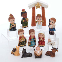 "Celebrate and remember the true meaning of Christmas in a new, fun way with this 1.6-4.5"" Children's Nativity, 13-Piece Set by Kurt Adler. Each adorable figurine in this set dressed up as one of the important figures of the first Christmas in Bethlehem, including a stable, the Holy Family, the Three Wise Men, an angel, a shepard, sheep, donkey, cow, and camel."