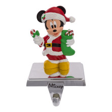 Hang up your favorite stocking this Christmas with this Mickey Mouse Stocking Holder from Kurt Adler! Perfect for the biggest Disney fans, Mickey Mouse is featured here wearing a red and white Santa-style outfit while holding a stocking of his own and a candy cane.