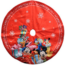 "Add the perfect finishing touch to your Christmas tree with this Disney Mickey and Friends Tree Skirt from Kurt Adler. This tree skirt features Mickey Mouse, Minnie Mouse, Donald Duck, Goofy, and Pluto dressed warmly while holding presents and mail on a red background with snowflake adornments. Bright red trim that reads, ""Ooh, Holiday joy!"