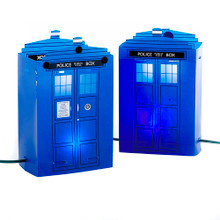 This 5-Light Doctor Who Tardis Luminary Outdoor decoration by Kurt Adler is a fun and unique way to add to your holiday decoration or collection - perfect for Doctor Who fans! The iconic Tardis is featured here 5 times in a luminary twelve-in style to truly light up your outdoor space and bring a sense of time-travelling fun to your holiday decor. Each set of 5 Tardis luminary lights features a 24-in lead wire, and 18-in spacing between each Tardis.