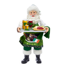 Part of Kurt Adler's Fabriche collection, this 10.5-in Musical Irish Chef Santa from Kurt Adler is a fun and festive addition to any holiday decoration. Perfect for showing off Irish pride! Santa Claus is featured here wearing a green santa hat and pants with a green shamrock apron. He is holding a tray with a plate of food and beer.