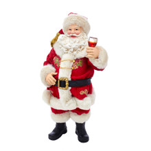 Part of Kurt Adler's Fabriche collection, this 10.5-in Wine Tasting Santa from Kurt Adler is a fun and festive addition to any holiday decoration. Santa Claus is featured here his traditional red and white suit with a holly berry accent. He is holding up a glass of wine with a cheery expression!