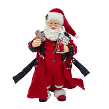 This Kurt Adler 12-in Fabriche Santa in Pajamas and Nightrobe is a fun and festive way to add to your holiday decoration! Santa Claus is wearing red nightrobe with sweets in his pockets. In one hand he has a mug and book and the other a gingerbread man.