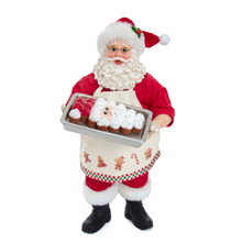 This 11-in Fabriche Ice Cream Santa is a sweet and trendy addition to any holiday decoration! Santa is featured wearing an apron with gingerbread cookies. In his hand is a baking pan is a Santa head pull apart cupcake cake. This Santa is the perfect addition to any trendy baker's holiday decoration!