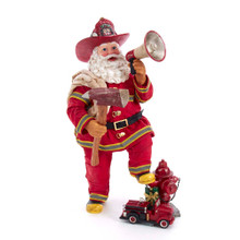 Celebrate the Fireman in your life with this Kurt Adler 11-in Fabriche Fireman Santa! This table piece features Santa wearing a classic fireman suit with a speaker phone in one hand and an axe in the other hand. He stands tall with one ft leaned on a fire hydrant. Near the fire hydrant is a small fire truck and wrapped presents.