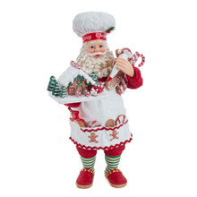 This 10.5-in Fabriche Gingerbread Chef Santa is a sweet addition to any holiday decoration! Santa is featured wearing an apron with gingerbread cookie detailing. The pockets of the apron are lined with treats and a rolling pin. His left arm holds more treats and icing bag. His right hand he proudly displays a gingerbread house. The cheery smile across his face is sure to brighten any holiday decoration!