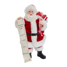 """Spread some holiday cheer with this 10.5-in Fabriche Santa with List and Gift Sack from Kurt Adler! Santa is in his classic red-and-white suit with a jolly smile. Slung over his shoulder is a sack overflowing with gifts. In his right hand is a list that says, """"Santa's Wish List... Peace, Love, Joy, Health"""". This table piece is a whimsical and fun addition to your holiday decoration!"""