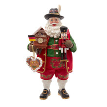 """This 11-in Fabriche Musical German Santa from Kurt Adler is the perfect addition to any German household. This Santa is featured in the classic red and green Christmas colors. In his left hand is a nutcracker. His right hand holds a simple Cuckoo clock, heart shaped ornament and the flag of Germany. When activated, the tune """"O Christmas Tree"""" plays."""