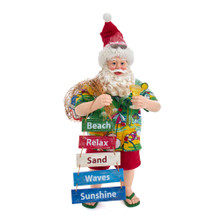 Part of Kurt Adler's Fabriche collection, this 10.5-in Fabriche Beach Santa from Kurt Adler is a fun and festive addition to any holiday decoration! Perfect for beach -goers, Santa Claus is featured here in a colorful Hawaiian shirt and red shorts. Sunglasses are embedded in his Santa hat. In one hand is a cocktail to get the party started. His other hand is a sack of party goods and a word ladder with beach motifs. This table piece is the perfect addition to any holiday beach party!